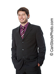 Satisfied young businessman with hands in pockets