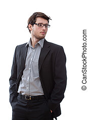 Serious businessman with hands in pockets, vertical
