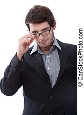 Businessman during looking seductively and wearing glasses