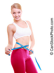 Diet. Fitness woman fit girl with measure tape measuring her...