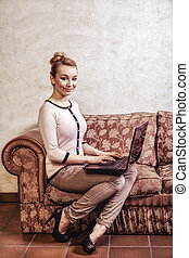 Business woman using computer. Internet home technology. Vintage photo.