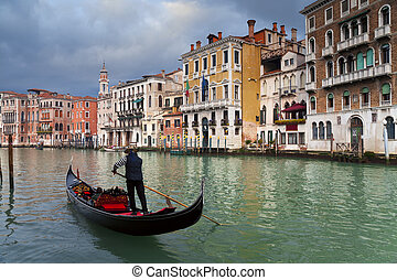 Gondolier. - Image of gondolier on Grand Canal in Venice.