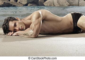 Beauty man - Beatiful fit man laying on exotic beach