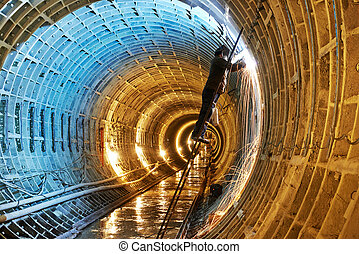 welder at underground subway construction site - Tuneller...