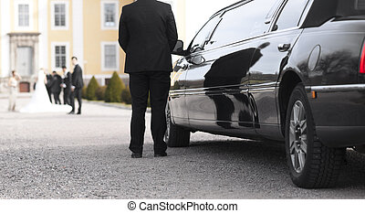Black limo at wedding - Black limo with driver waiting for...