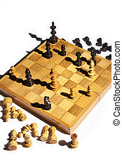 chess board in checkmate - chess board with pieces in...