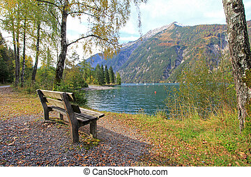 A bench along with Achensee Lake during Autumn in Tirol,...