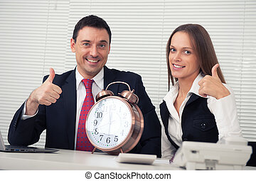 business couple showing thumbs up in the office - happy...