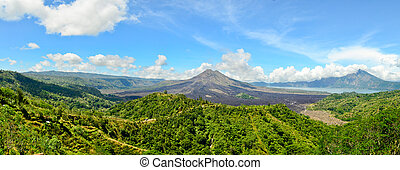 Panoramic view of Batur volcano in the sunshine day -...