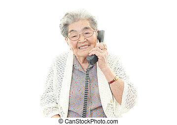 Smiling old woman - Portrait of old woman on a white...