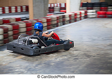 Indoor karting race kart and safety barriers