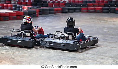 Indoor karting race 2 kart and safety barriers