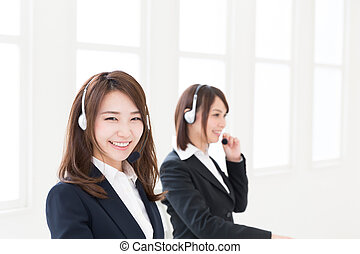 Operator - young attractive asian businesswoman with headset