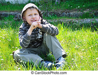 Boy Pointing His Finger On The Right - boy sits on the...