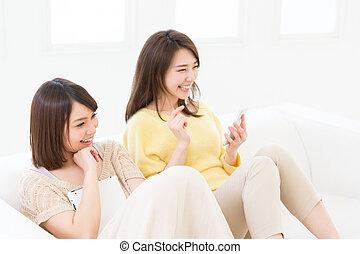 woman using tablet computer - Beautiful young asian women...