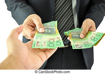 Hand receiving money - Australian dollar - from a...