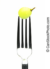 Forked - Grape on a fork isolated against a white background
