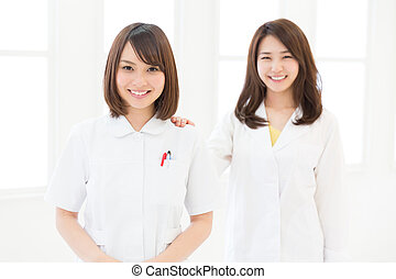 Young nurse and doctor - Young attractive asian nurse and...
