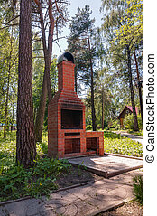 Barbecue grill oven outdoors in green forest