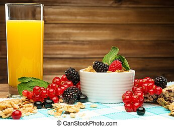 Healthy breakfast with fresh orange juice on tablecloth in...