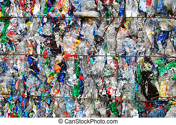 Plastic waste - Shreddered plastic bottle on a recycling...