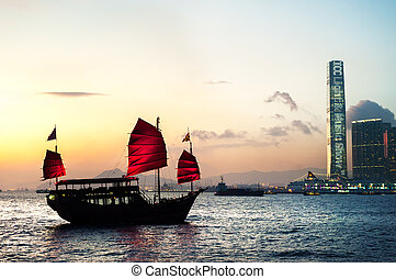 Traditional junk crossing Victoria Harbour, Hong Kong - HONG...