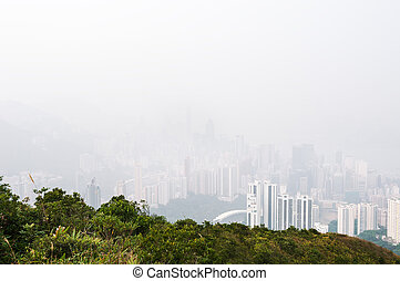 Hong Kong island obscured by haze, as seen from the hills...