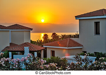 Sunset over holiday beach villas