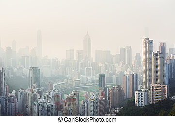 Air pollution hangs over the Happy Valley district of Hong...