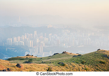 Hong Kong obscured by air pollution, as seen from the...
