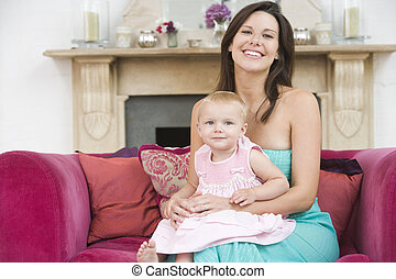 Mother in living room with baby smiling