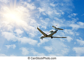 business jet - Private business jet airplane flying on blue...