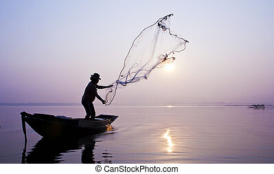 Fishermen are catching fish with a cast net. - Fishermen are...