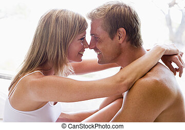 Couple cuddling - man and women cuddling indoors