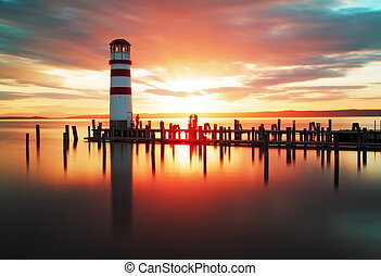 Beach sunrise with lighthouse - Beach sunset with lighthouse