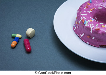 Various medicines to combat diabetes along with a sweet cake...