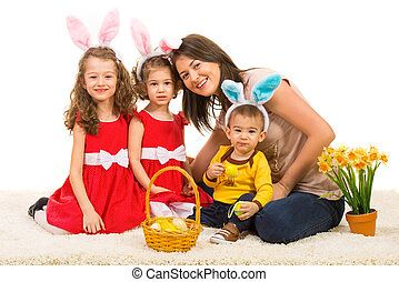 Happy easter family - Happy mother with her kids wearing...
