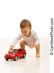 Baby boy playing with car toy