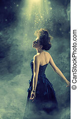 Glamour lady dancing in the fogg - Glamour woman dancing in...
