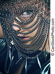 Young woman with chain mask