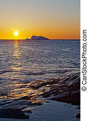 Newfoundland coastline at sunrise.