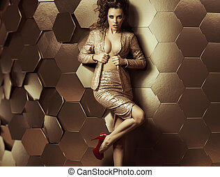 Sexy woman leaning against wall of plates - Sexy woman...