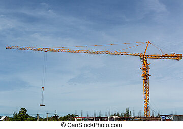 Construction crane - A tall construction crane against the...