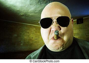 Mobster in a dark room - Image of a mobster, gangster, or...