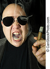 Mobster smoking a cigar - Image of a mobster, gangster, or...