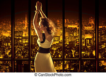 Relaxed woman on the top of the building - Relaxed woman on...