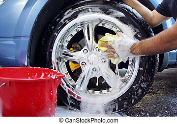 Car washing - Man's hand washing a mag wheel on car...