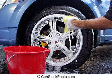 Car washing - Mans hand washing a mag wheel on car...