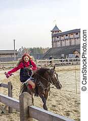 Woman on the horse in ancient Ukrainian national costume.