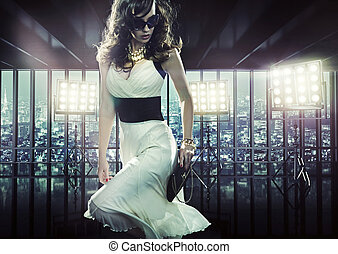 Elegant woman during photo session - Elegant young woman...